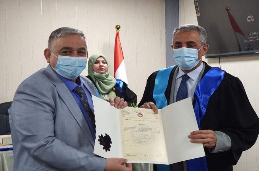 تدريسي في جامعة كركوك يترأس لجنة مناقشة اطروحة دكتوراه في جامعة الموصل
